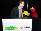 PSE&G President Ralph LaRossa teams up with Sesame Street's Elmo to unveil Let's Get Ready, a free emergency preparedness app for children, at the Ironbound Early Learning Center in Newark. (PRNewsFoto/Public Service Enterprise Group)