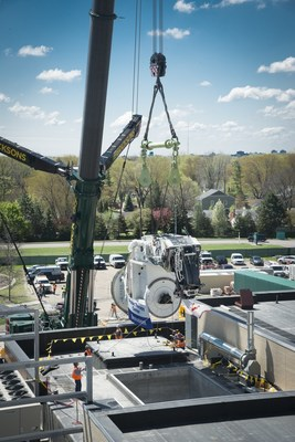 Crews lift and lower the Proton Center gantry into place at Beaumont Hospital, Royal Oak.