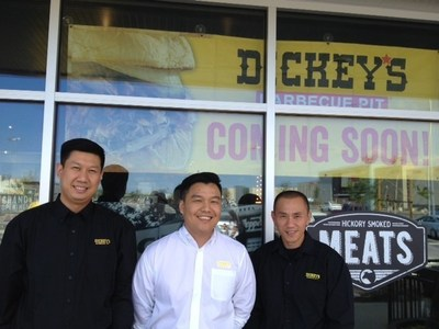 Owner/Operators and brothers-in-law Tat Wong, Alan Cheung and Kevin Vuu (left to right) celebrate the grand opening of their Downey location this Thursday.