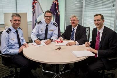 Royal Australian Air Force's Air Commodore Adam Brown, Air Vice-Marshal Leigh Gordon, AM, CSM and Lockheed Martin Australia representatives, Raydon Gates and Jon Rambeau sign the Australian Pilot Training System contract.