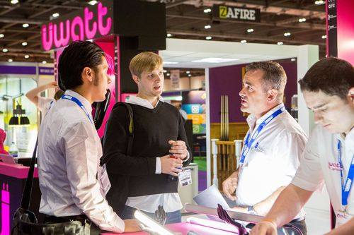 Exhibition attendees discussing business at the Energy & Environment Expo 2014