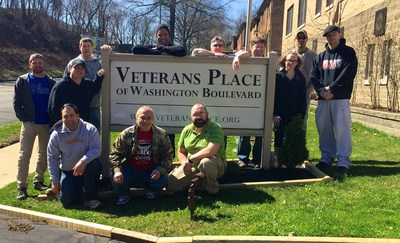 Wounded veterans gather to landscape local homeless veterans home.