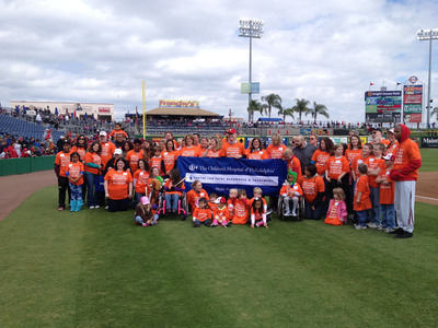 The Center for Fetal Diagnosis and Treatment at The Children's Hospital of Philadelphia (CHOP) brought together a unique community of families from across Florida: all former CHOP patients who either underwent fetal surgery to treat conditions before birth, or needed specialized care or surgery immediately after birth. The group gathered at the spring training home of the Philadelphia Phillies, Bright House Field in Clearwater, Florida.  (PRNewsFoto/The Children's Hospital of Philadelphia)