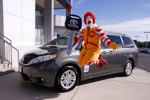 Ronald McDonald jumps for joy over the donation of a Toyota Sienna minivan to the Ronald McDonald House of ...