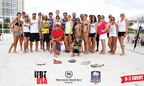 (Center) Steve Culver, Beach Tennis Pro and the Activities Coordinator for Sheraton Sand Key Resort with Competitors from around the world at the 2014 Sand Key Beach Tennis Open. (PRNewsFoto/Sheraton Sand Key Resort)