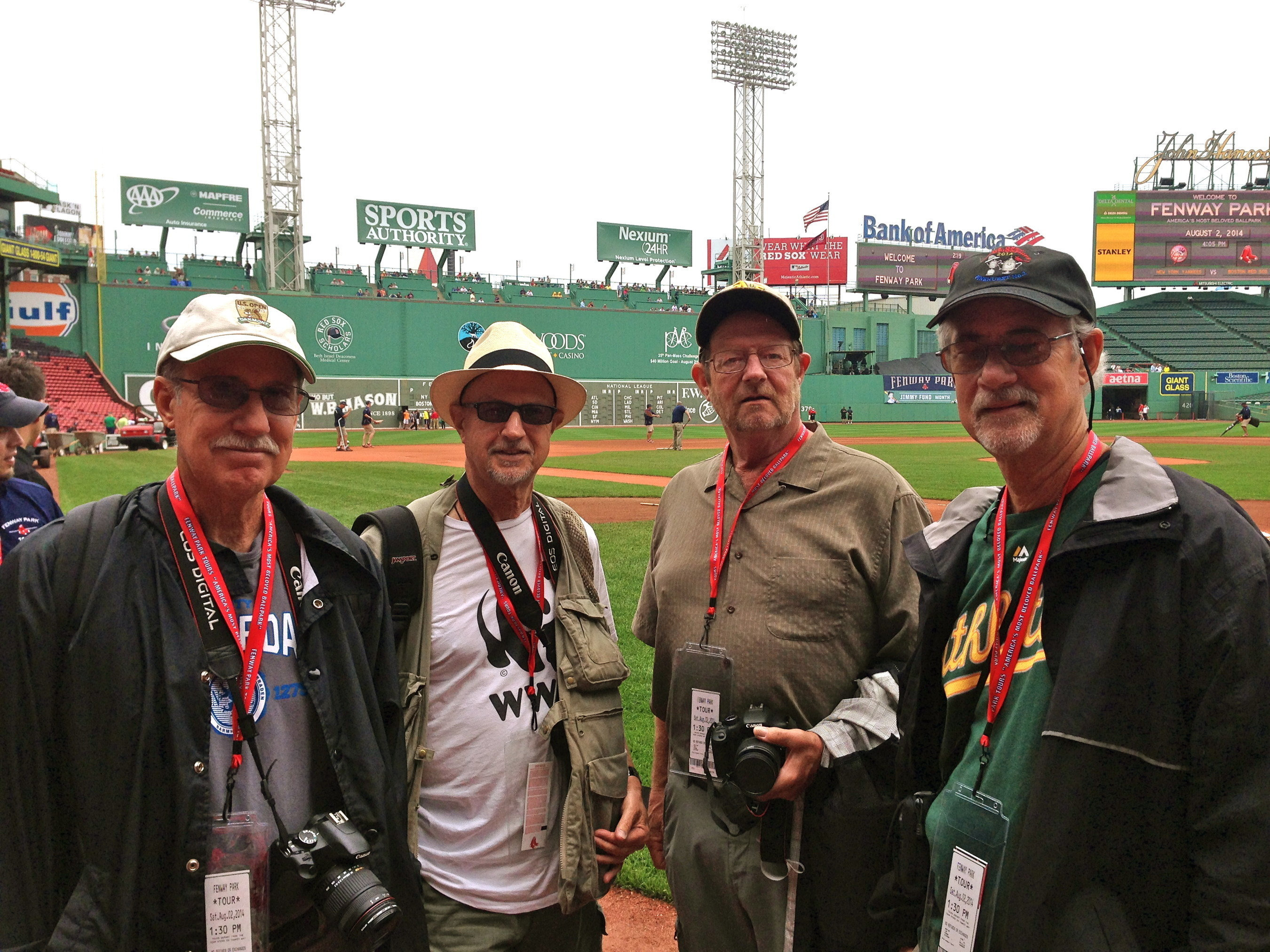 John Rosskopf (second from the left) and lifelong buddies enjoy being on field at Fenway Park while on their East Coast bucket list baseball tour.