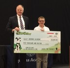 """The Outdoor Power Equipment Institute (OPEI)'s Research and Education Foundation and Scholastic recently announced the winners of TurfMutt's national """"Be a Backyard Superhero"""" contest. Pictured are Kris Kiser, president and CEO of OPEI, and grand prize winner for grades 3-5, Liam Ellis, of Sewickley, Pa. when a check for $5,000 was presented to Aquinas Academy of Pittsburgh to improve yards and green spaces at the school. The annual contest is part of the TurfMutt..."""