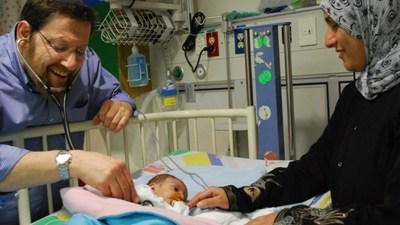 Prof. Azaria JJT Rein, head of pediatric cardiology at Hadassah and cofounder of A Heart for Peace, tending to a Palestinian patient. Photo courtesy A Heart for Peace