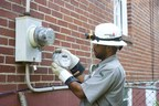 "A Georgia Power employee replaces a mechanical meter with a digital ""smart"" meter in 2009. The meters are a part of the company's smart grid, which is reducing the frequency and duration of power outages."