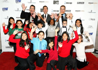 Shining Stars Ed Helms (Center) and Teacher Richard Meyer (Left) pose with Host Andy Richter (Right) and students on the red carpet at Education Through Music-Los Angeles' 11th Annual Benefit to raise support for music in schools. www.etmla.org