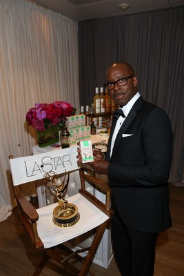 "Actor Courtney B. Vance, recipient of the the award for outstanding lead actor in a limited series or a movie for ""The People v. O.J. Simpson: American Crime Story"" with L.A. Star Greens Perfect 10 organic Superfood."