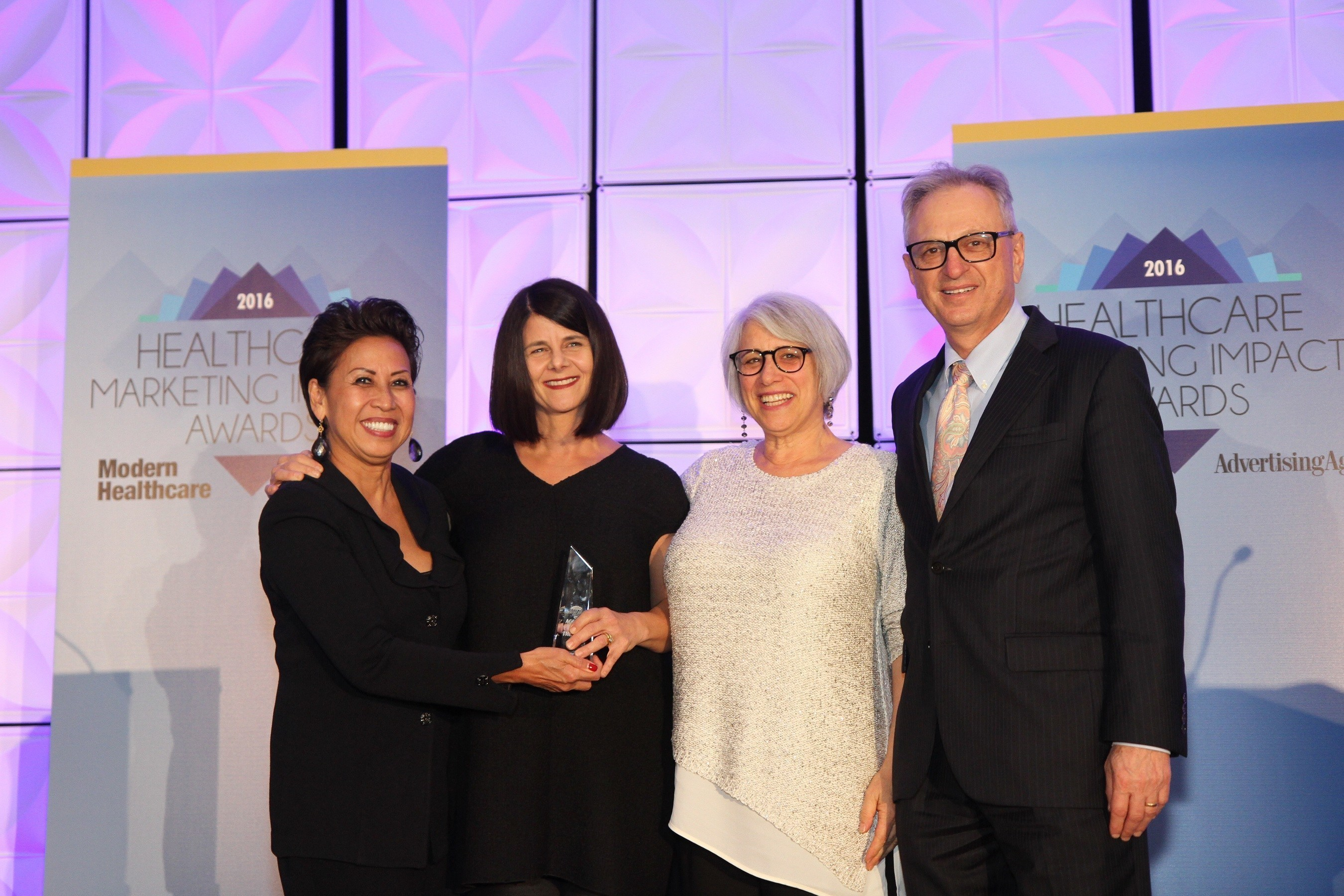 The Bloc named Agency of the Year at 2016 Healthcare Marketing Impact Awards in Chicago. (Left to right): Fawn Lopez, Publisher and Vice President, Modern Healthcare; Elizabeth Elfenbein, Creative Partner, and Robin Tzannes, Creative Director, The Bloc; Merrill Goozner, Editor, Modern Healthcare.