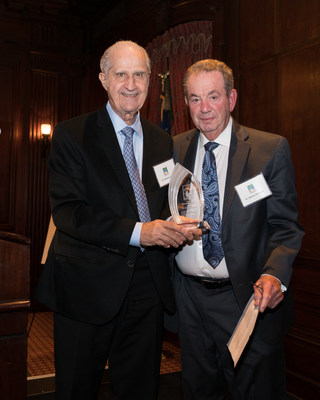 Dr. Anthony Volpe, left, presented Dr. Sidney Whitman with the Special Recognition Award at the Dr. Edward B. Shils Entrepreneurial Fund's annual awards ceremony.