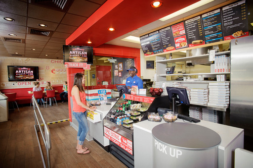 "Domino's Pizza introduces the ""Pizza Theater"" - its store of the future, putting the art and skill ..."