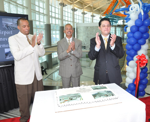 City of Houston Controller Ronald Green (left); Houston Airport System Director of Aviation Mario C. Diaz (center); and Houston City Council Member James G. Rodriguez unveil a cake during the official celebration of the $250 million project.  (PRNewsFoto/Houston Airport System)