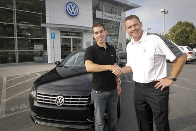 First 2012 Passat owner, Matt Duchesne, receives his all-new Volkswagen from Mike Gabbani, General Sales Manager at Stevens Creek Volkswagen, in San Jose, CA.  (PRNewsFoto/Volkswagen of America, Inc.)