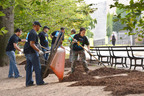"The GM Foundation on Tuesday announced a $100,000 donation to the Central Park Conservancy to support and expand its ""Keeping it Green"" service learning program for students. To mark the donation and ""teamGM Cares Week,"" volunteers from General Motors' offices spread mulch and completed other tasks in Central Park.  (PRNewsFoto/General Motors Foundation)"