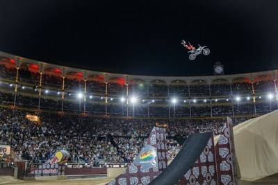 A Red Bull X-Fighters freestyle motocross rider in mid-air during a 2015 event in Madrid, Spain.