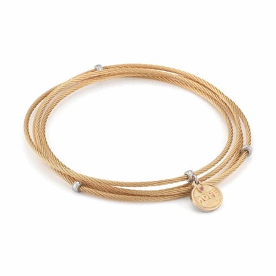 ALOR's 'HOPE' Affirmation Bracelet, a 4-row bangle in blush stainless steel with an 18K gold and pink sapphire-studded 'HOPE' charm.