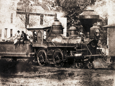 """This engine, named Astron, which means """"Star,"""" was built by Norris and Sons and acquired by NCRR in 1855, rebuilt in 1862 and again in 1870. This photo was made at Company Shops in Burlington in 1880. Photo: N.C. Archives. (PRNewsFoto/North Carolina Railroad Company) (PRNewsFoto/NORTH CAROLINA RAILROAD COMPANY)"""