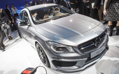 2014 Mercedes-Benz goes toe to toe with BMW 128i.  (PRNewsFoto/Loeber Motors)