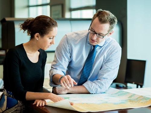 Young Fednav employees collaborating on projects (PRNewsFoto/Fednav Ltd)