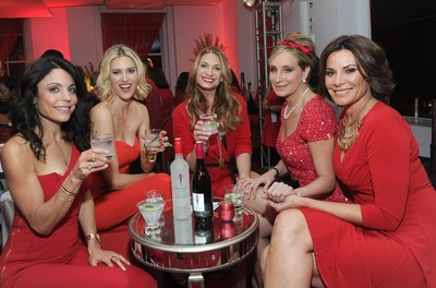 "The original Skinnygirl Bethenny Frankel, left, poses with fellow ""Real Housewives of New York"" cast members Kristen Taekman, second left, Heather Thomson, center, Sonja Morgan and Luann de Lesseps, right, at the ""Boy Meets Skinnygirl Cocktails"" Valentine's Launch Party, Tuesday, Feb. 10, 2015 in New York. The group joined Frankel as she unveiled Skinnygirl Spicy Lime Margarita and Skinnygirl Pinot Noir at the event benefiting Dress for Success. (Photo by Diane Bondareff/Invision for Skinnygirl Cocktails/AP Images)"