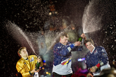 Kyle and Scott Croxall with Arttu Pihlainen celebrate their podium victories after Red Bull Crashed Ice in Saint Paul.  (PRNewsFoto/Red Bull)