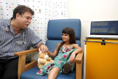 Prof. Moshe Phillip (Left) with a child connected to the MD-Logic system (PRNewsFoto/Schneider Children's Center)