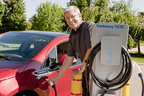 Dr. Luis Lorenzo, vice president, Advanced Product Engineering, Corporate Functions, Freudenberg-NOK, fuels up a Chevy Volt at Freudenberg-NOK's new electric vehicle charging station.  (PRNewsFoto/Freudenberg-NOK Sealing Technologies/2011 TIF EDWARD LLEWELLYN OCHAL)