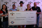 """Kid Rock was in Dallas last month to present a $50,000 check on behalf of Beam Inc. to Operation Homefront, a non-profit organization that provides emergency financial and other assistance to the families of our service members and wounded warriors. Kid Rock was joined by Operation Homefront COO Amy Palmer, guests of honor, Army Sgt. Ralph Harroff and his wife, Lorie Harroff, and Frederick """"Fred"""" Booker Noe III, seventh generation Beam master distiller.  Ralph was injured while serving in Afghanistan, and has received assistance from Operation Homefront since returning home. His family was the recent recipient of a new home under the Homes on the Homefront program.  (PRNewsFoto/Beam Inc.)"""