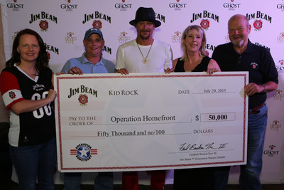 "Kid Rock was in Dallas last month to present a $50,000 check on behalf of Beam Inc. to Operation Homefront, a non-profit organization that provides emergency financial and other assistance to the families of our service members and wounded warriors. Kid Rock was joined by Operation Homefront COO Amy Palmer, guests of honor, Army Sgt. Ralph Harroff and his wife, Lorie Harroff, and Frederick ""Fred"" Booker Noe III, seventh generation Beam master distiller.  Ralph was injured while serving in Afghanistan, and has received assistance from Operation Homefront since returning home. His family was the recent recipient of a new home under the Homes on the Homefront program.  (PRNewsFoto/Beam Inc.)"