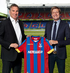 Joel Leonoff, president and CEO of Optimal Payments and Steve Parish, Crystal Palace chairman, show-off the new NETELLER(R)-branded Crystal Palace Football Club shirts as part of Optimal Payments' official sponsorship of the club for the 2014-15 and 2015-16 Premier League seasons. (PRNewsFoto/Optimal Payments Plc)