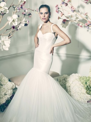 The 'Truly Zac Posen' line, available exclusively at David's Bridal, showcases gowns that exude glamour and femininity.  (PRNewsFoto/David's Bridal)
