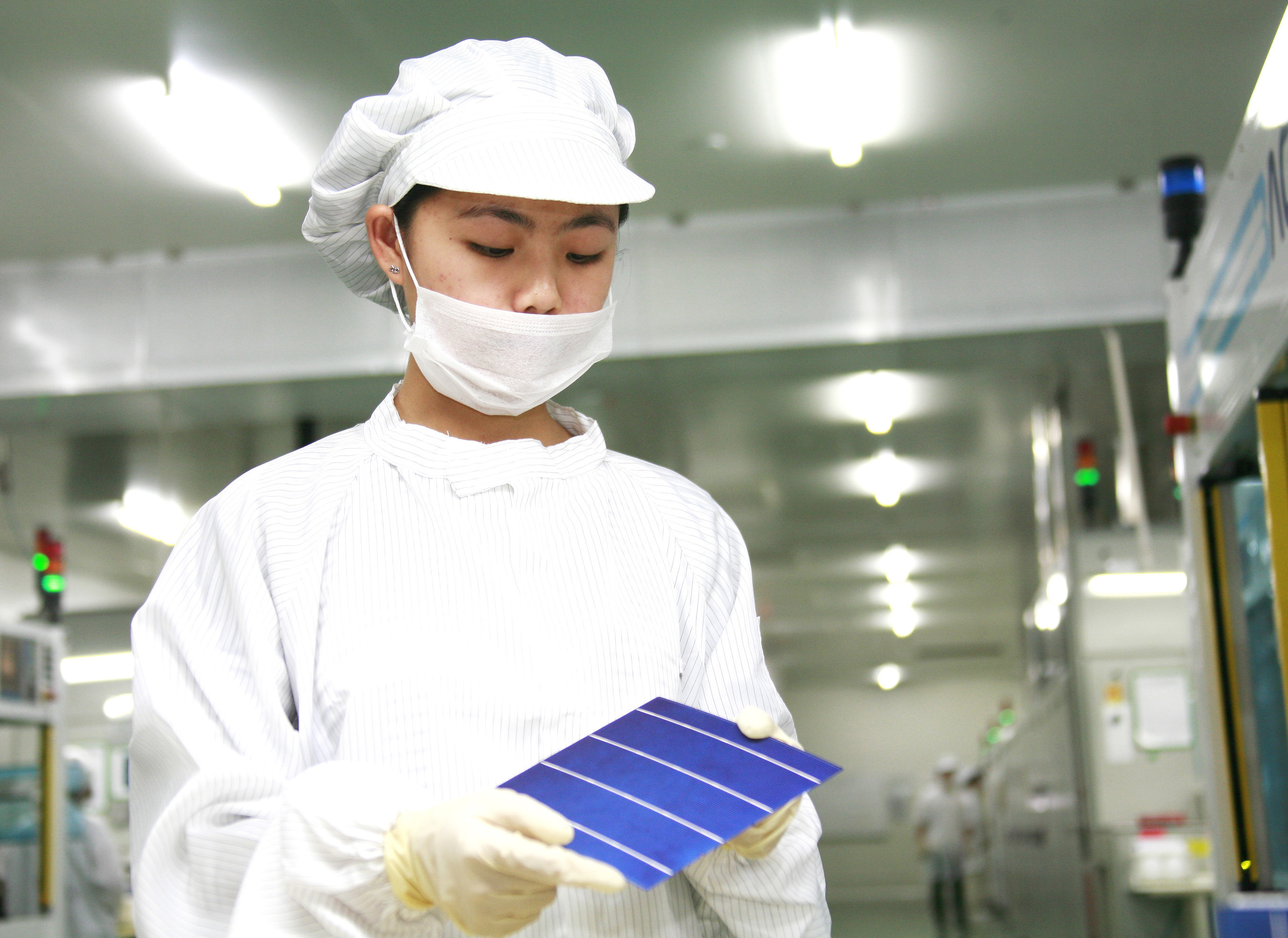 A Suntech worker inspects a HyPro cell
