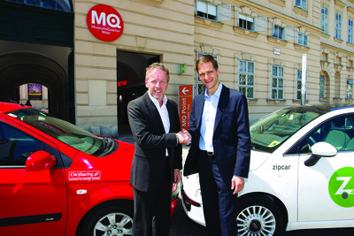 Frerk-Malte Feller, president of Zipcar Europe (right) shakes hands with Christof Fuchs, managing director of DENZEL Mobility CarSharing GmbH, after Zipcar's acquisition of CarSharing.at in Austria on July 11, 2012.  (PRNewsFoto/Zipcar, Inc.)