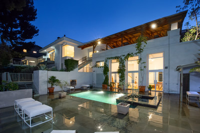 Academy Award-winning cinematographer Wally Pfister, known for his work on the Dark Knight films, among others, has listed his compound in Hollywood Hills West for sale at $4.495 million with Mimi Starrett and Aaron Kirman of John Aaroe Group.