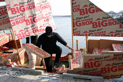 "The ""sea"" delivery was completed when the Hutflower - a replica of the Mayflower made of Big Dinner Boxes - arrived near Plymouth Rock in Plymouth, Mass. Big Dinner Boxes were then unloaded from aboard the Hutflower and introduced to America at the birthplace of Thanksgiving.  (PRNewsFoto/Pizza Hut)"