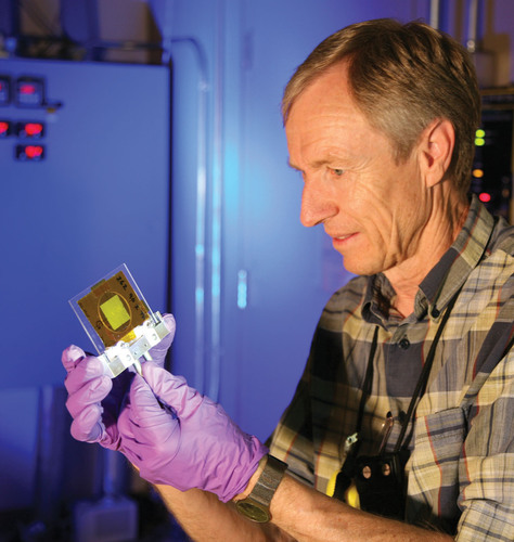 Los Alamos scientist Meiring Nortier holds a thorium foil test target for the actinium 225 production ...