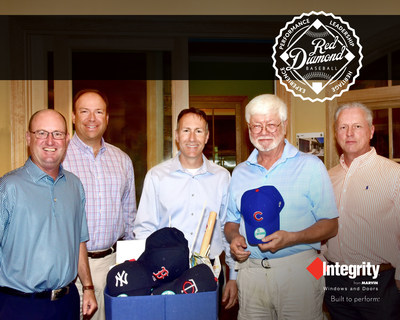 Integrity Windows and Doors Senior Territory Manager Rob Hardy, Architectural Vision Inc. President Peter Morrison, Integrity Windows and Doors Vice President of Sales Todd Antonelli, Red Diamond Baseball winner Dennis McConnell and Architectural Vision Inc. Sales Representative Mark Van Tillburg celebrate McConnell's win in Atlanta, Ga. with a bundle of baseball apparel and game-day essentials.