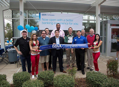BBVA Compass and local dignitaries in The Woodlands celebrate the bank's new Alden Bridge location at 8100 Research Drive on Saturday. They were joined by former Houston Rockets player Robert Horry, in back, and two dancers for the Houston Rockets.