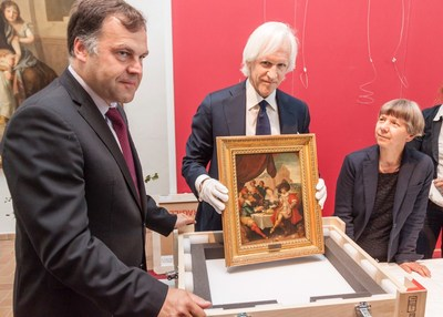 Robert M. Edsel, Founder and Chairman of the Monuments Men Foundation for the Preservation of Art, holds one of five paintings the Monuments Men Foundation discovered and turned over to the Federal Republic of Germany in 2015 for return to their rightful owners. These paintings are part of the hundreds of thousands of cultural items, missing since the end of the war, which the Monuments Men Foundation hopes to help recover in the coming years.