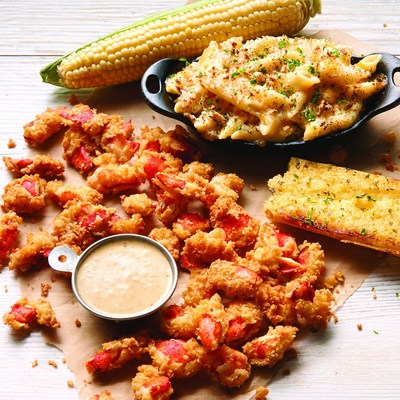 Joe's Crab Shack is offering up a new set of featured menu items this fall, including Southern Fried Maine Lobster, providing guests with a more relaxed approach to seafood. The new Southern Fried Maine Lobster entree features hand-breaded lobster meat and is served with a fresh ear of corn, house-baked macaroni and cheese, toasted garlic bread and Old Bay(R) spiked cream sauce. These hands-on dishes are available now through mid-November at Joe's Crab Shack restaurant locations. (PRNewsFoto/Joe's Crab Shack)