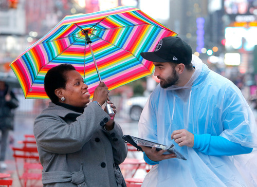 Brand Ambassadors for Office 365 show passersby in New York's Times Square how to get it done from anywhere using technology in honor of Microsoft's global Get It Done Day on Nov. 7. (Gary He/Insider Images for Microsoft Office 365).  (PRNewsFoto/Microsoft Corp.)