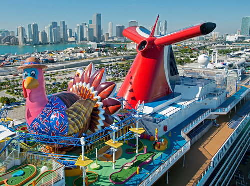 To celebrate Thanksgiving a 50-foot-high inflatable turkey was positioned atop the Carnival Breeze when the ship arrived in Miami today. The new 130,000-ton ship makes its inaugural sailing from Miami tomorrow.  (PRNewsFoto/Carnival Cruise Lines)