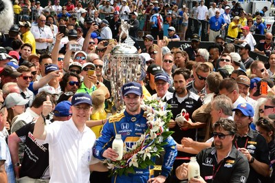Standing beside the Borg-Warner Trophy(TM) in Victory Lane, BorgWarner President and Chief Executive Officer James Verrier congratulated Alexander Rossi on his victory at the 100th running of the Indianapolis 500. Photo courtesy of Robert Banayote for BorgWarner.