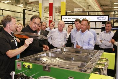 Grand Opening Guests Viewing Magneti Marelli production technologies.