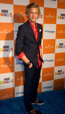 Showcasing his Hallmark Text Band, teen singing sensation Cody Simpson walks the red carpet at a Hallmark Text Bands launch party.