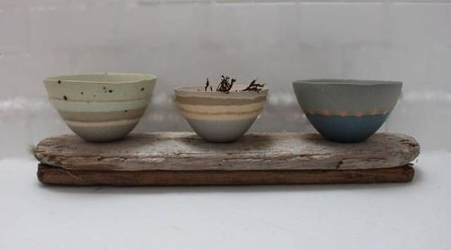 Charlotte Jones bowls hand made from clay from Cornish beaches and inspired by Cornish landscapes and flowers. (PRNewsFoto/Rocke _ Nutter)