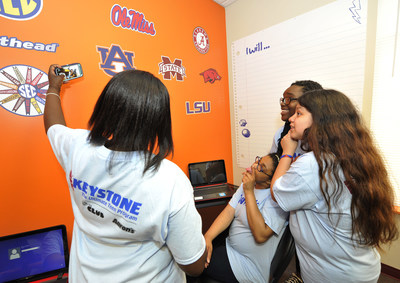 Keystone Club members of Franklin Branch Boys & Girls Clubs of Middle Tennessee take a selfie in the new study room remodeled by Aaron's, Inc. associates.  Aaron's, Inc. donated laptops, desks, furniture, TVs and game systems and painted the Keystone Club rooms to create a lounge, entertainment and study area for the teens.